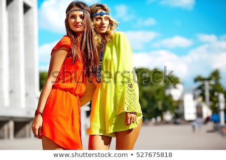 two beutiful brunette girls in casual fashion and accessory  Stock photo © juniart