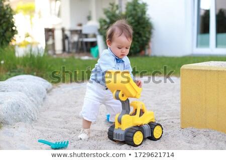 jonge · glimlachend · spelen · speelgoed · trekker - stockfoto © feverpitch