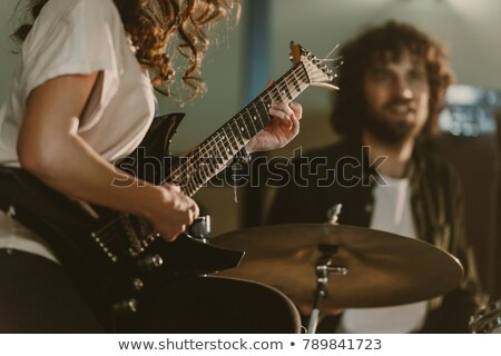 Female guitarist and drummer Stock photo © sumners
