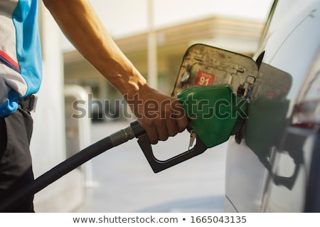 Stock photo: Girl with benzine pump.