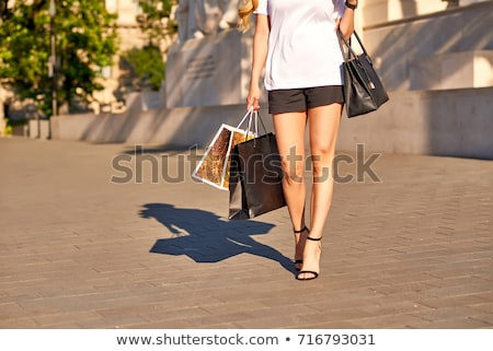 Walking shopping woman holding bag on the city square close up Stock photo © denisgo