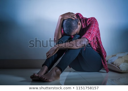 Expressive African American Woman With Dramatic Lighting Stock photo © tobkatrina