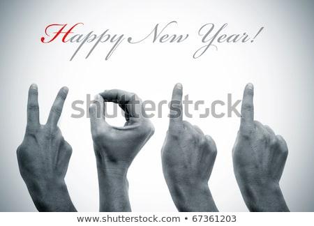 Szöveg 2011 kezek tart új év kéz Stock fotó © timbrk