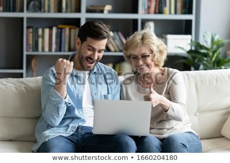 madre · ensenanza · sesión · sofá · casa · sonriendo - foto stock © monkey_business