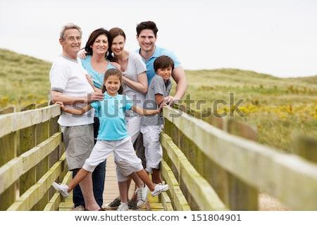 Multi Generation Family Walking Along Wooden Bridge Stock photo © monkey_business