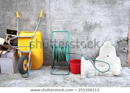 wheelbarrow hose and cartons stock photo © smuki