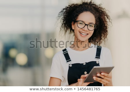Young woman reading a tablet in the darkness Stock photo © dash