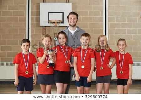Masculina escuela equipo deportivo gimnasio nino Foto stock © HighwayStarz
