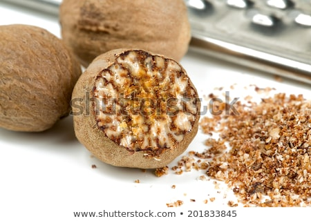 grind nutmeg with grinder Stock photo © jirkaejc