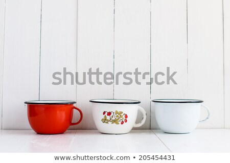 three bright colorful enameled mugs stock photo © manera