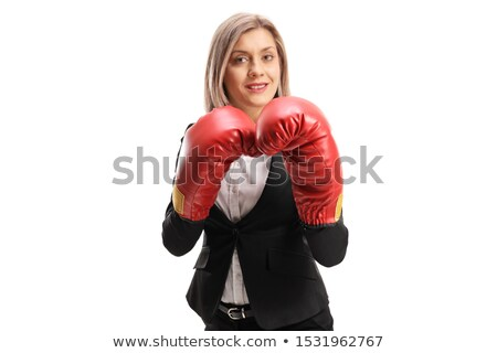 Businesswoman wearing boxing gloves standing in protective pose, isolated on a white background Stock photo © deandrobot