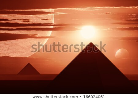 Distant World with two Planets and Egyptian style Pyramids Stock photo © ankarb