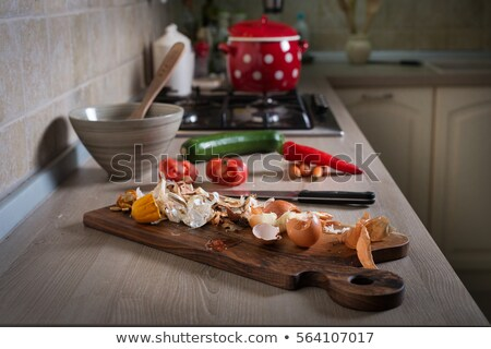 Organic Wastes on Wooden Chopping Board with Knife Stock photo © ozgur
