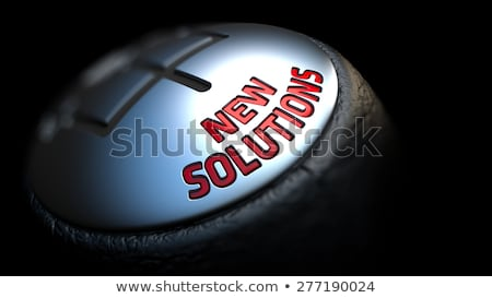 New Solutions on Gear Stick with Red Text. Stock photo © tashatuvango