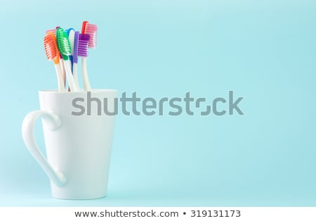 Toothbrush And Mug Photo stock © Kenishirotie