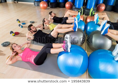 Muscular man and woman workout with fitball Stock photo © deandrobot