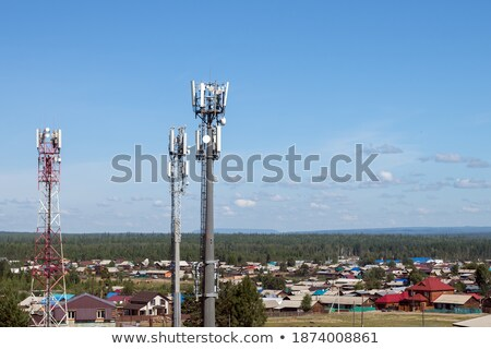 Cellular tower in sunny summer day Stock photo © ironstealth