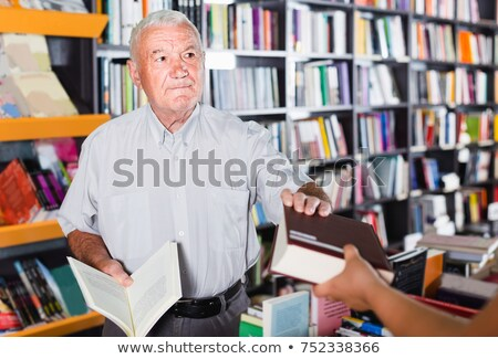 Portrait Of Male Customer Reading Book In Bookstore Stock photo © HighwayStarz