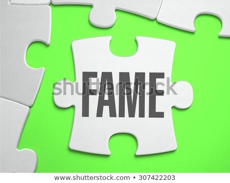 Fame - Jigsaw Puzzle with Missing Pieces. Stock photo © tashatuvango