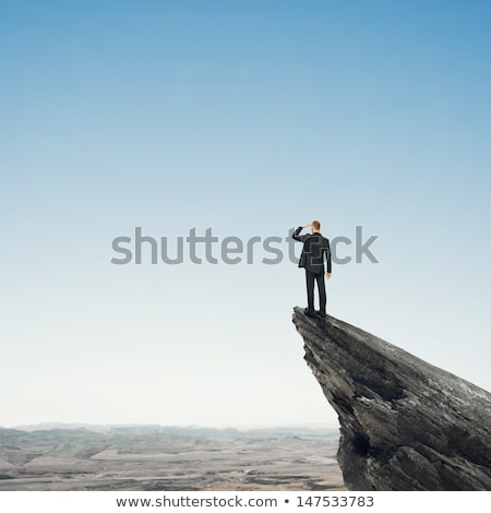 Business man relaxes on the stone Stock photo © alphaspirit