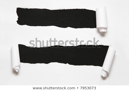 Stock photo: the two sheet of paper with the hole against the black background