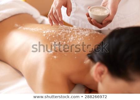 Female Getting A Salt Scrub Treatment Stock photo © dash
