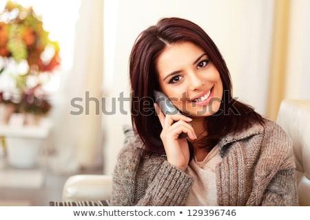 happy woman in sweater talking on phone stock photo © dash