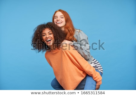 Csinos boldog fiatal nő sötét hosszú haj áll Stock fotó © deandrobot