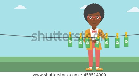 Woman loundering money. Stock photo © RAStudio
