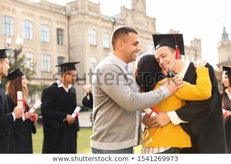 A happy man graduating Stock photo © bluering