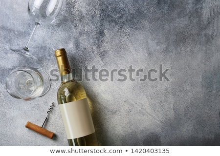 Glass with white wine on a white background Stock photo © Zerbor