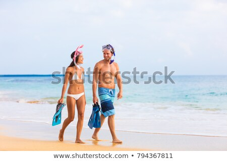 Stock photo: man and woman with fins and scuba mask