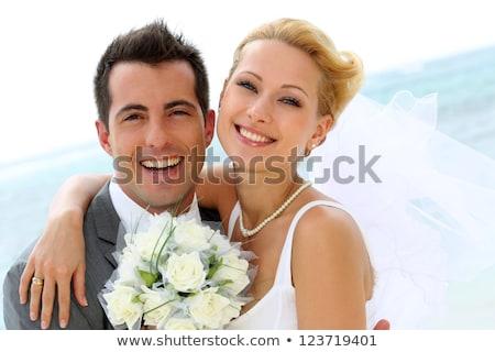 Heiter Ehepaar stehen Strand Sonnenuntergang Mann Stock foto © deandrobot