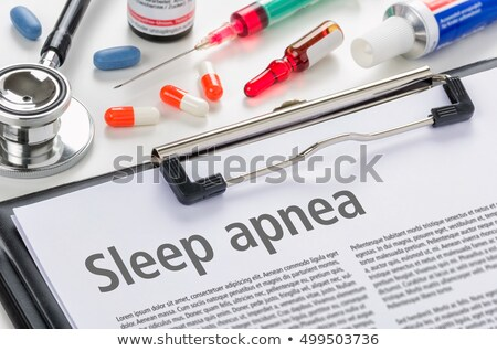 The diagnosis Sleep apnea written on a clipboard Stock photo © Zerbor