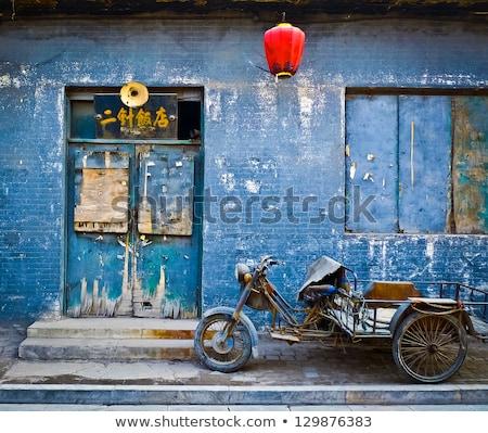 Weathered brick wall and old blue window Stock photo © stevanovicigor
