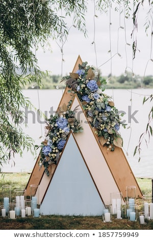 Sunset. Wedding ceremony arch closeup with flower arrangement an Stock photo © Victoria_Andreas