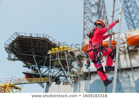 Man omhoog werken reparatie gelukkig bouw Stockfoto © Bigbubblebee99