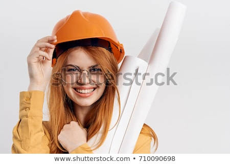 Young woman in helmet with the work tools on a white Stock photo © vlad_star