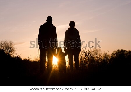 father with child at sunset stock photo © adrenalina