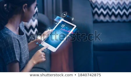 doctors thinking about exams data with a tablet stock photo © giulio_fornasar