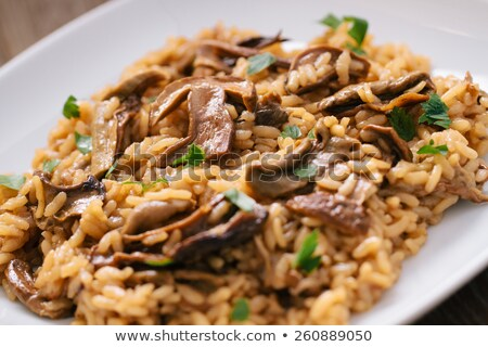bowl of wild mushroom risotto stock photo © monkey_business