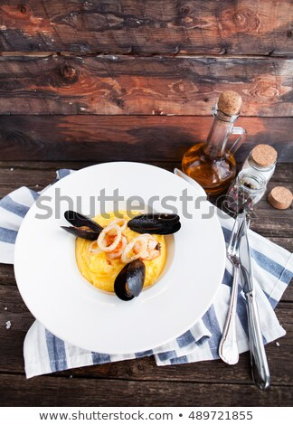 mussels rings of squids and a shrimp and a garnish from potatoe stock photo © yatsenko
