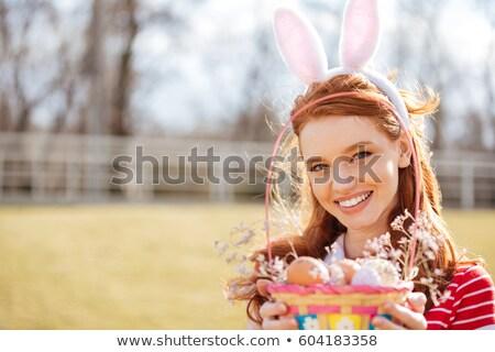 Heureux fille lapin oreilles Photo stock © deandrobot