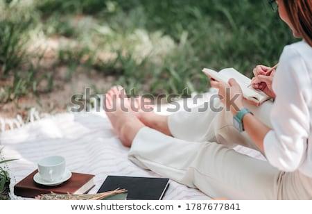 woman writing outdoors stock photo © artfotodima