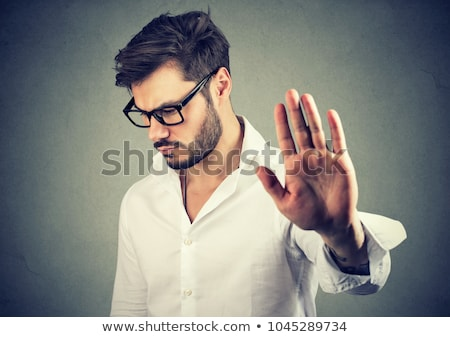 bad man expressing anger with face and hands Stock photo © Giulio_Fornasar