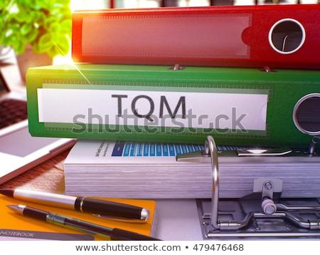 Green Office Folder with Inscription TQM. Stock photo © tashatuvango
