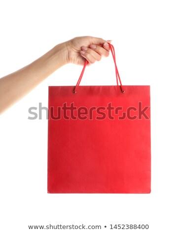 Kéz tart színes bevásárlótáskák izolált fehér Stock fotó © julenochek