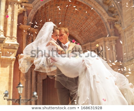 Groom carrying bride Stock photo © IS2