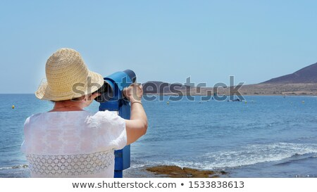 mature woman looking across sea stock photo © is2