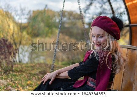 Girl Looking to camera set against sky Stock photo © IS2